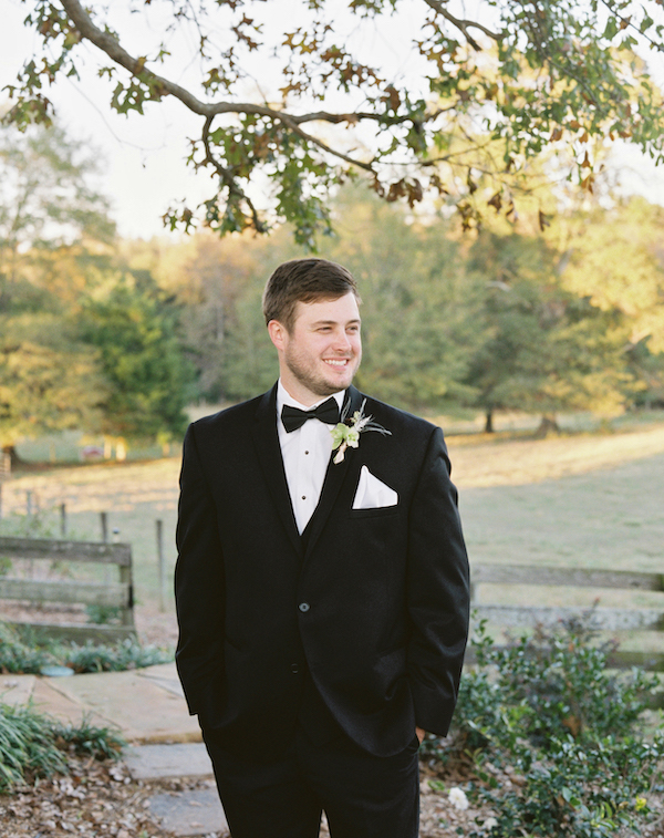 The groom was wearing a classic black tux with a bright boutonniere