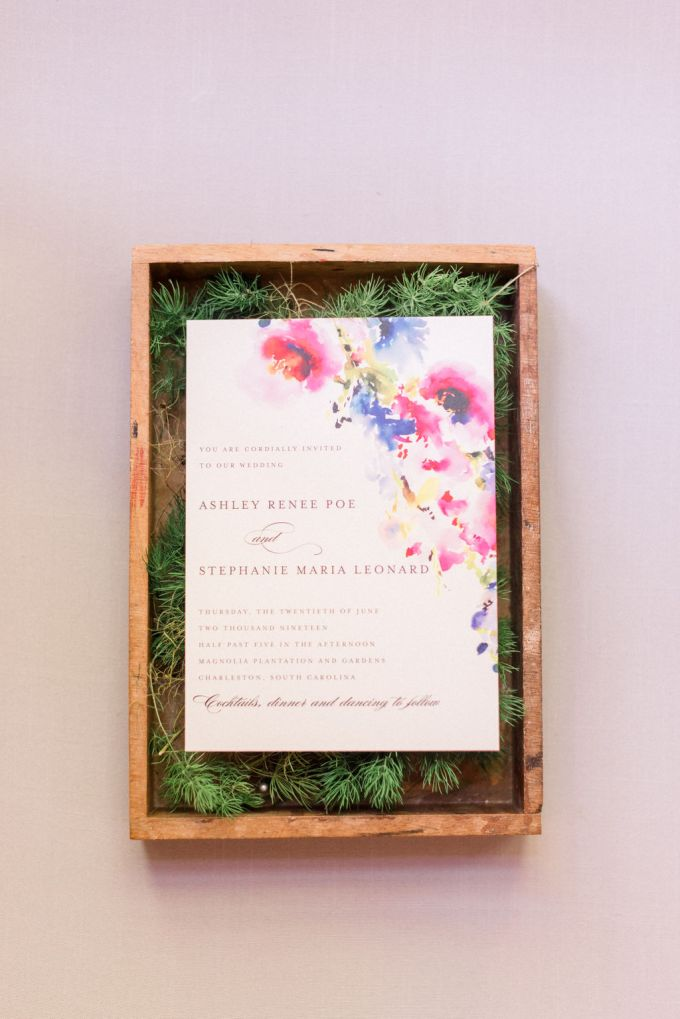 The wedding stationery reflected the wedding decor - it was watercolor in all bright shades