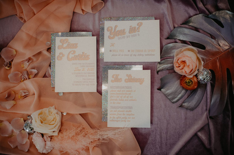 The wedding stationery was done in peachy pink, with silver glitter and retro printing