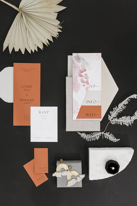 The wedding stationery was done with color blocking, in white and rust shades