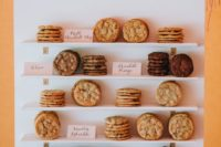 02 a mini cookie wall with shelves, calligraphy, greenery and various kinds of tasty cookies for a modern wedding