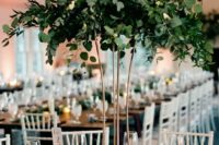 02 a tall greenery centerpiece is a cool statement idea that won't require much money