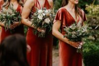 02 burgundy velvet maxi dresses with V-necklines is a stylish and refined choice to go for, perfect for fall and features much texture