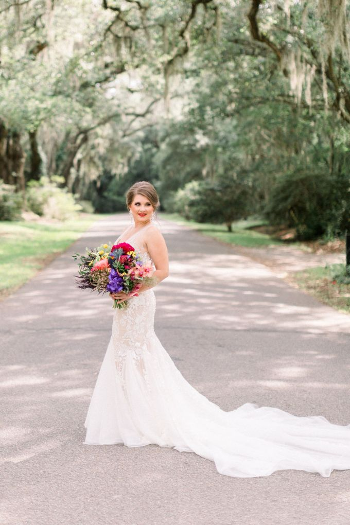 One bride was wearing a gorgeous mermaid wedding dress with floral appliques and a train