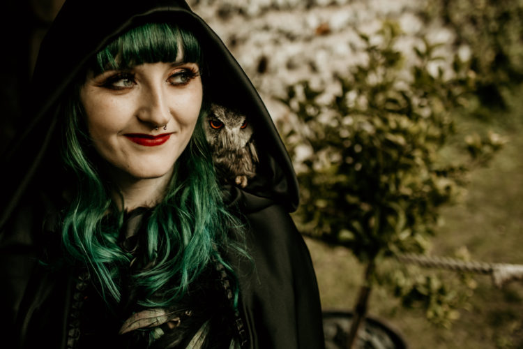 The bride was rocking green hair and a dark cloak, she was carrying a real owl