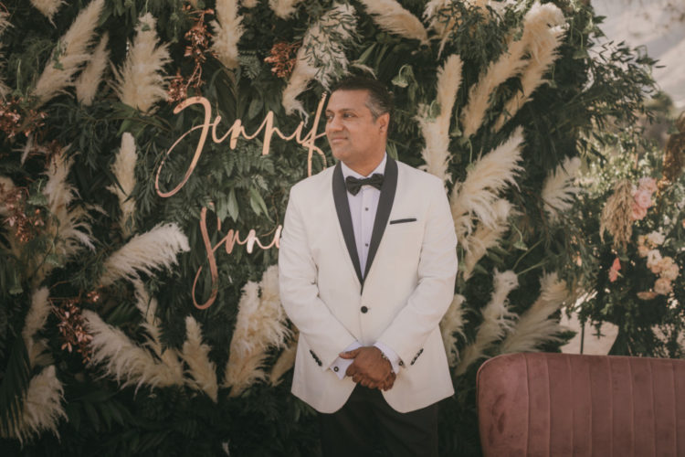 The groom was rocking a white tux with black lapels