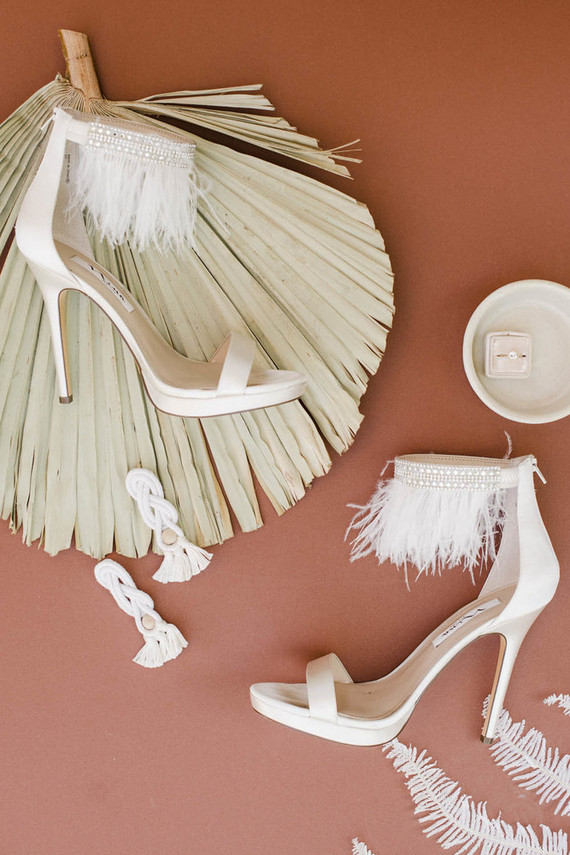 The wedding shoes were fringed lace ones, and the earrings were statement fringe ones