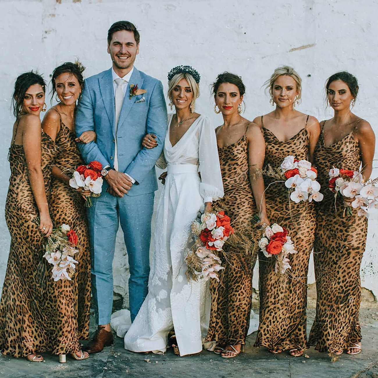 matching leopard print bridesmaid dresses on psaghetti straps are chic and cool