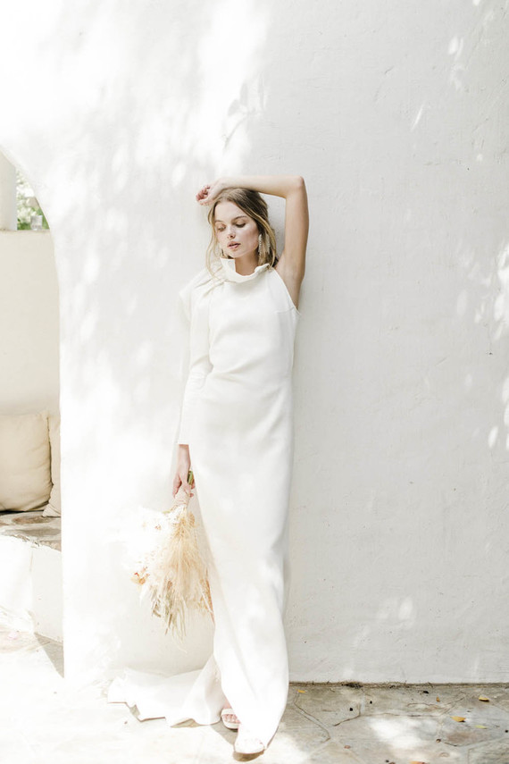 One wedding dress was a minimalist masterpiece with one sleeves and draperies plus a train
