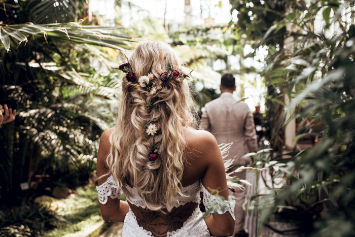She was rocking a braided half updo with dried blooms and greenery tucked into it