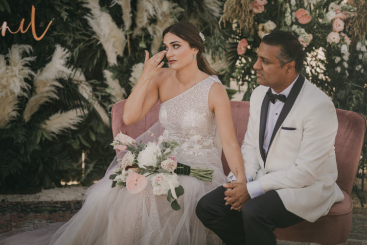 The bride was carrying a chic and quirky pink and white wedding bouquet