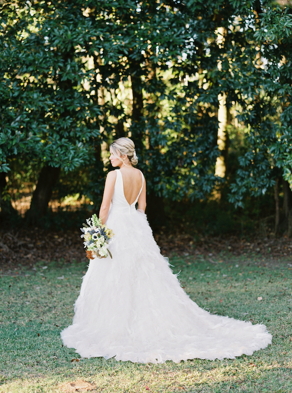 The first wedding dress was an A-line one, with a feather skirt, a cutout back and a modern plain bodice