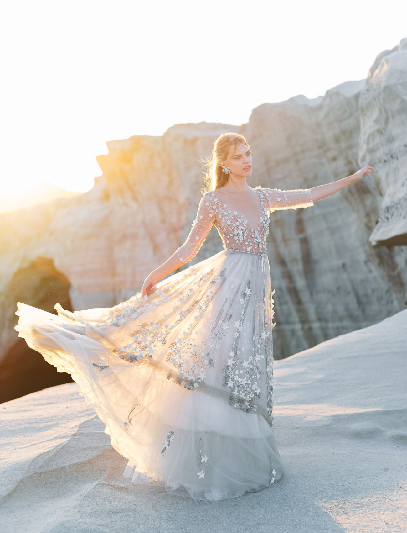The jaw dropping wedding dress was with a star bodice and a layered skirt also decorated with stars