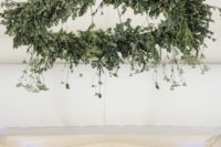 04 a statement greenery chandelier with hanging elements takes over the whole reception space