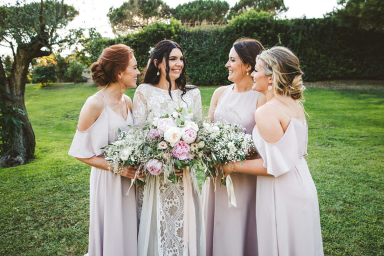 The bridesmaids were rocking mismatched blush maxi gowns
