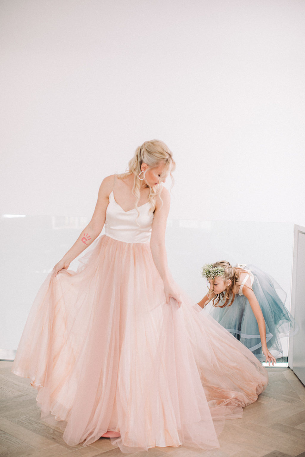 The daughter of the bride was wearing a similar ensemble but in blue