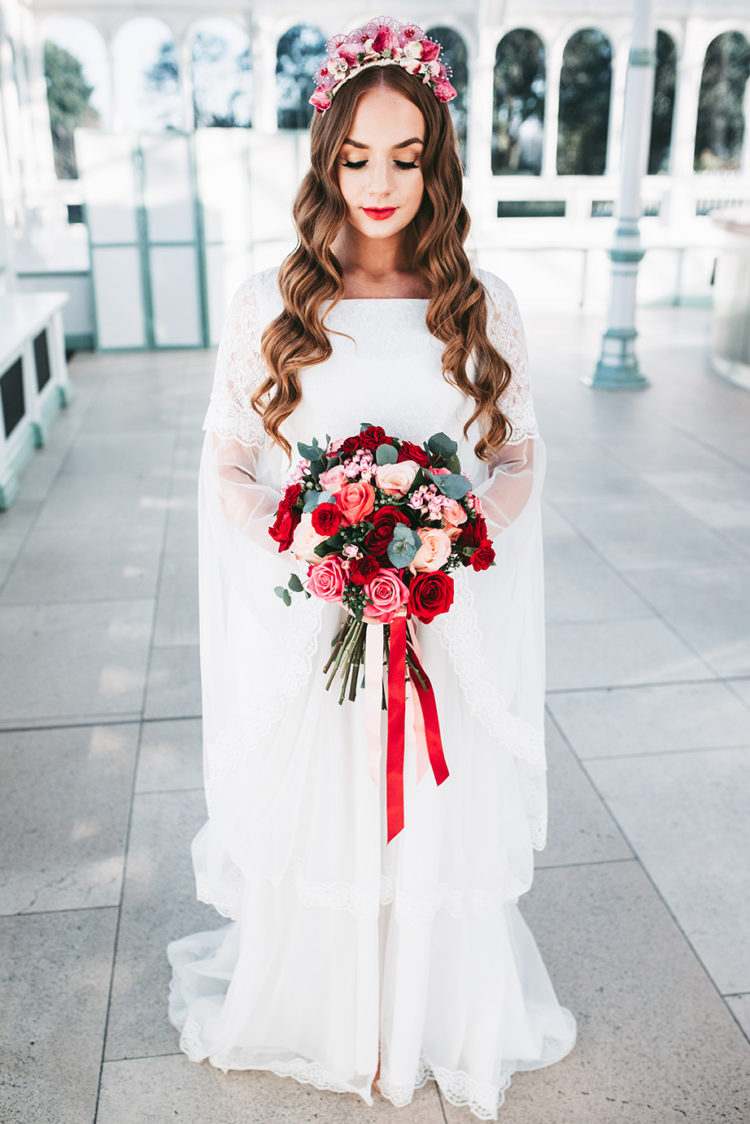 The second wedding dress was a lace one with a capelet, the makeup matched - a red lip and long lashes