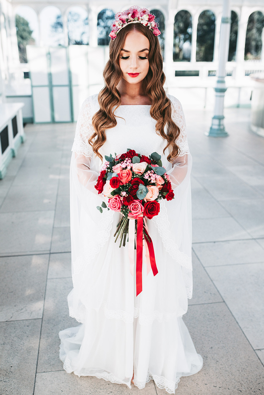 The second wedding dress was a lace one with a capelet, the makeup matched   a red lip and long lashes