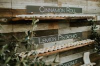 05 a reclaimed wooden wall with shelves and various delicious donuts is a cool idea for a rustic or farmhouse wedding