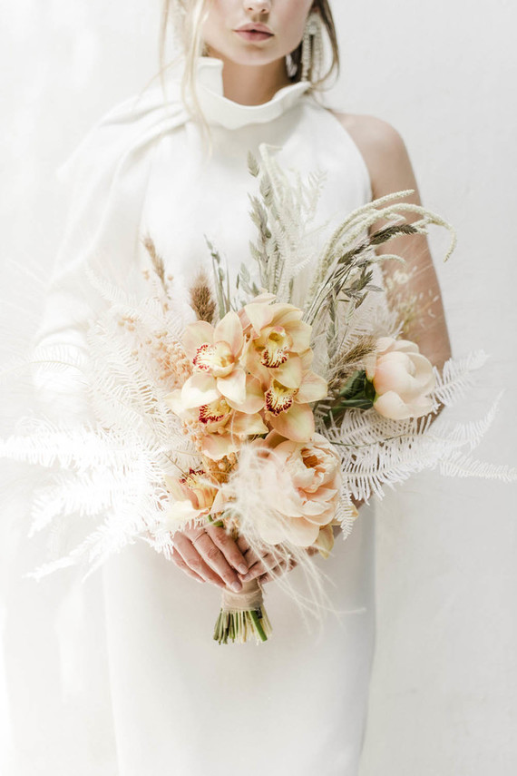 I love the tender and airy pastel bloom and dried blooms and herbs wedding bouquet