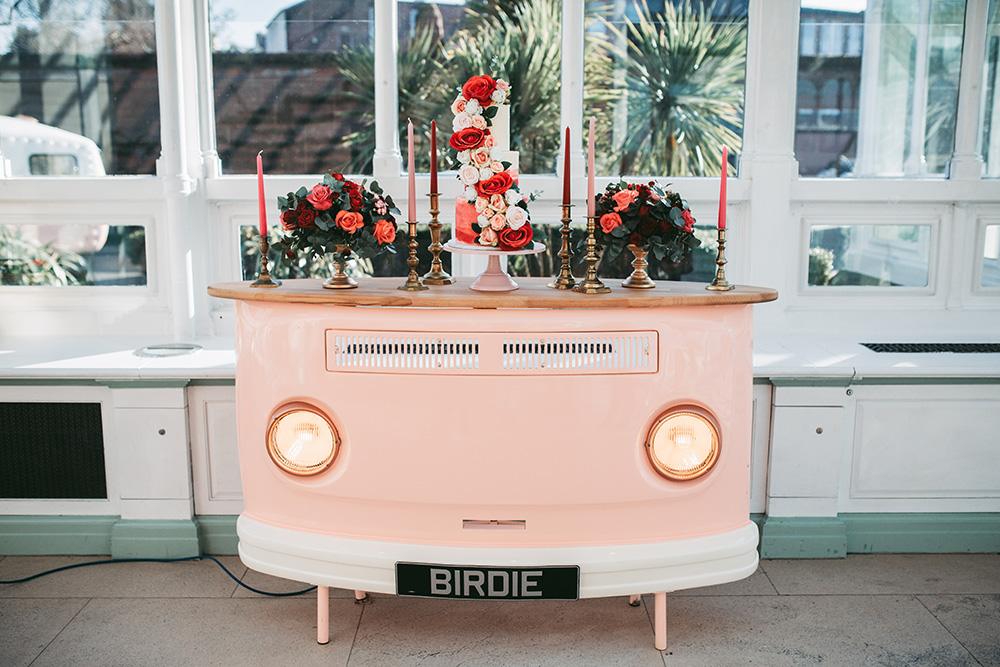 The wedding cake bar was a pink one, styled as a retro van, red and pink candles and a gorgeous cake