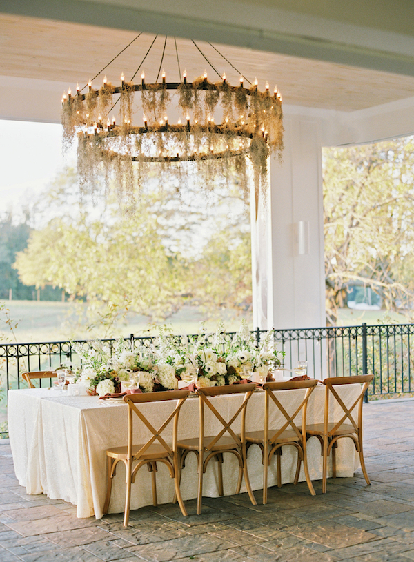 The wedding reception was very cozy and chic, with a large moss covered chandelier and white florals