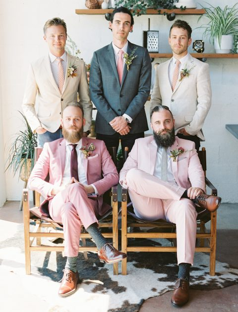 chic pink and light pink wedding suits, mismatching ties and brown shoes plus bright boutonnieres for a brigth summer wedding