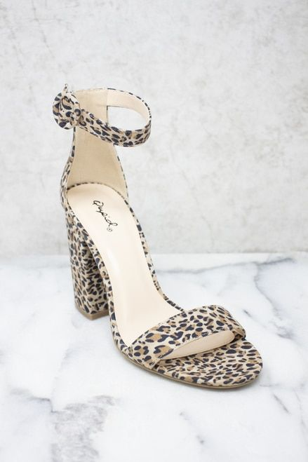 leopard print wedding shoes with block heels and ankle straps are a statement accessory in your bridal look