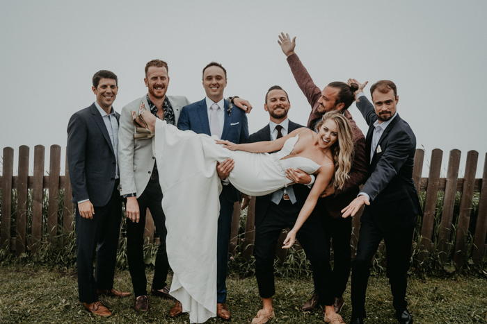 The groomsmen were rocking mimsatching looks with suits and printed shirts