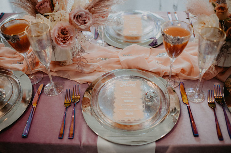 The table was styled with silver plates, disco balls, silver cutlery and gold rim glasses plus a mauve tablecloth