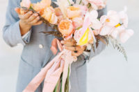07 The wedding bouquet was romantic and pastel, with blush and peahcy blooms and pampas grass