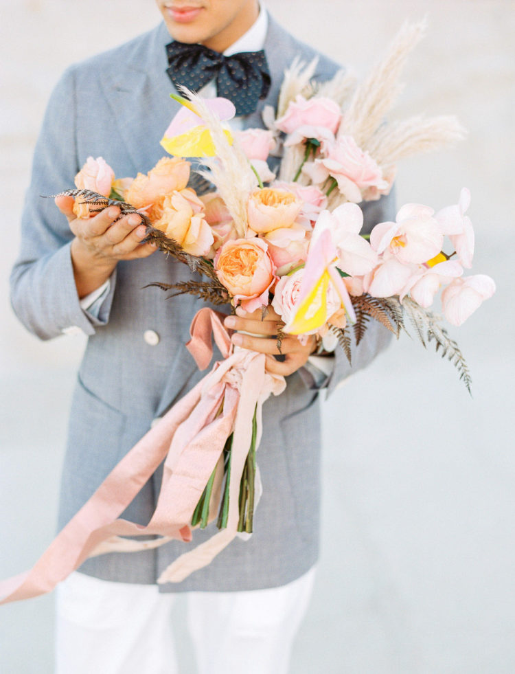 The wedding bouquet was romantic and pastel, with blush and peahcy blooms and pampas grass