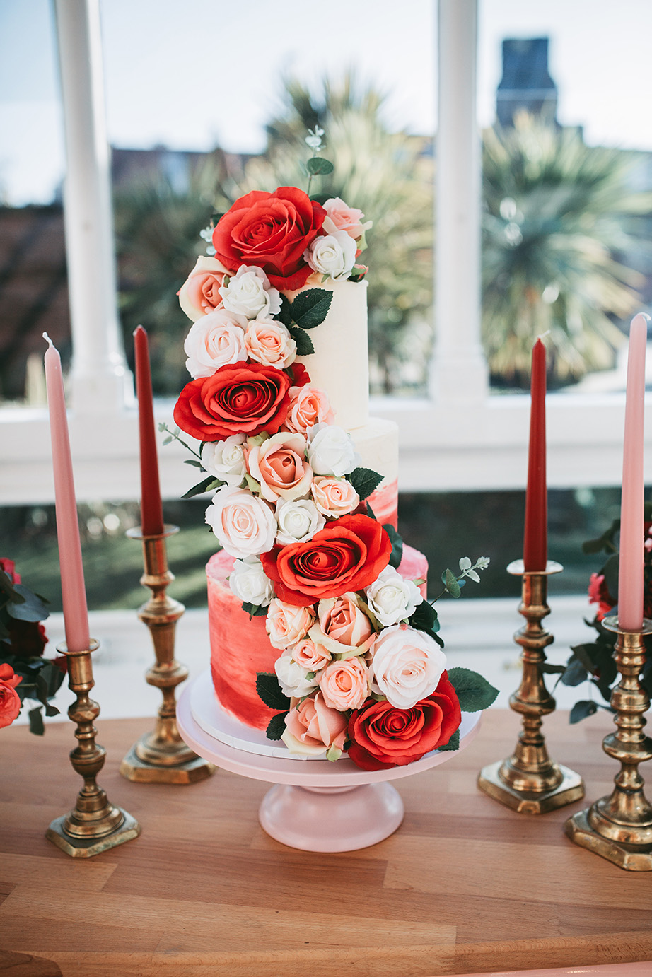The wedding cake was an ombre red one, with lush red, pink and white blooms and greenery