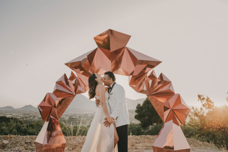 There was a bold copper geometric 3D wedding arch as a backdrop for the portraits
