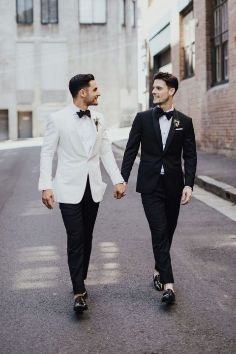 contrasting black and white tuxedos with black bow ties and shiny shoes for a refined formal wedding