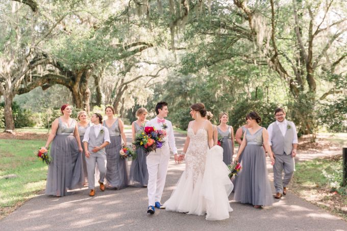 The bridesmaids were wearing grey maxi dresses with embellished bodices and groomsmen and groomsladies were wearing grey suits