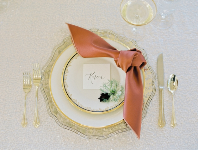 The place setting was done with gold rim plates, gold cutlery and colored napkins
