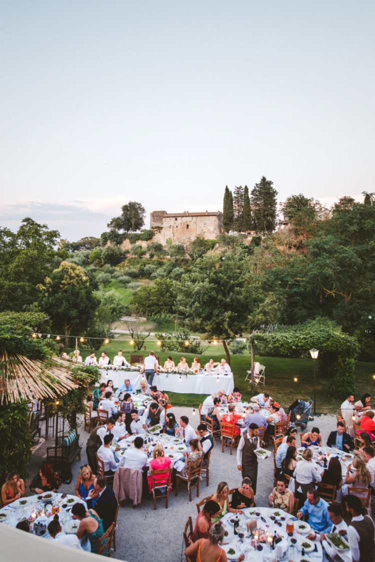 The reception was an outdoor one, with lights, greenery and a view of a palace