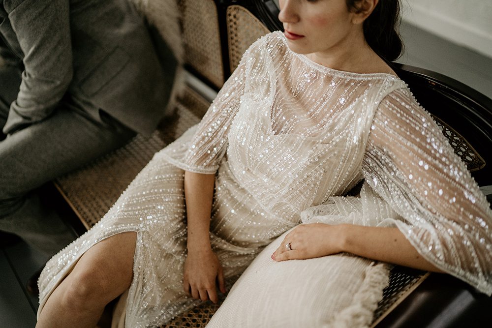 The second wedding dress was a fully embellished short sleeve illusion neckline one with a front slit