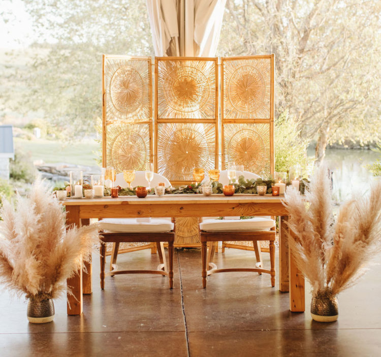 The sweetheart table was styled with pampas grass, woven screens, greenery table runners and candles
