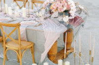 08 The table was decorated with delicate linens, pastel florals, candles and pink glass chargers