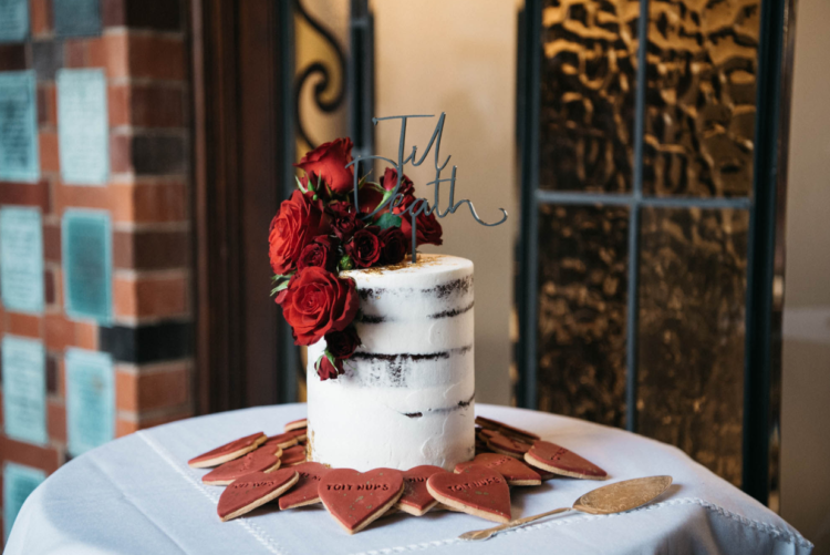 The wedding cake was a naked one, with burgundy roses and there were lots of red heart-shaped hearts