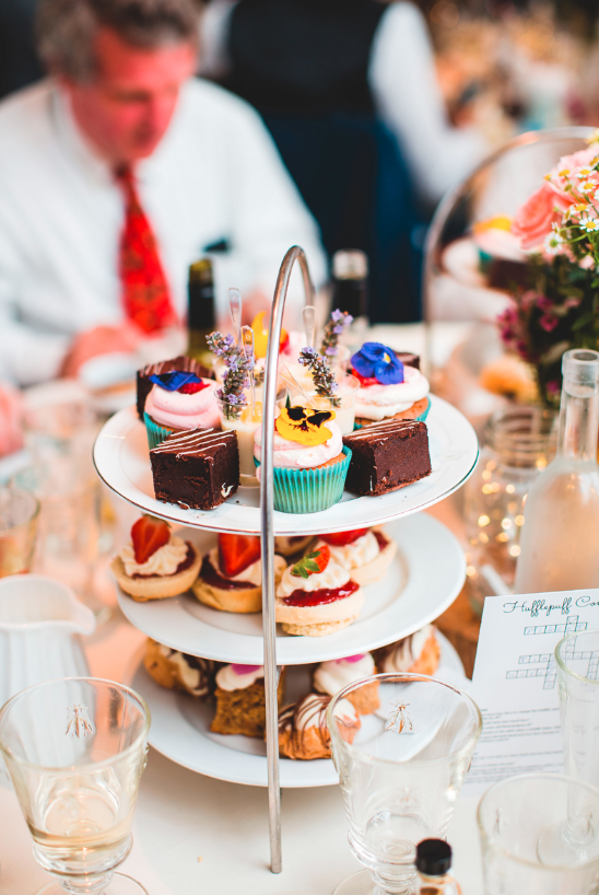 The wedding sweets were all different and topped with colorful edible blooms and berries