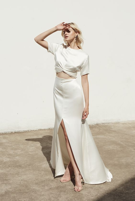 a minimalist bridal separate with a silk crop top with short sleeves and an A-line maxi skirt with a front slit