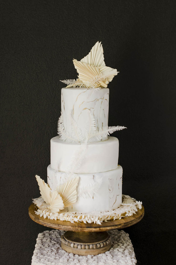 The wedding cake was a marbleized white one topped with dried fronds