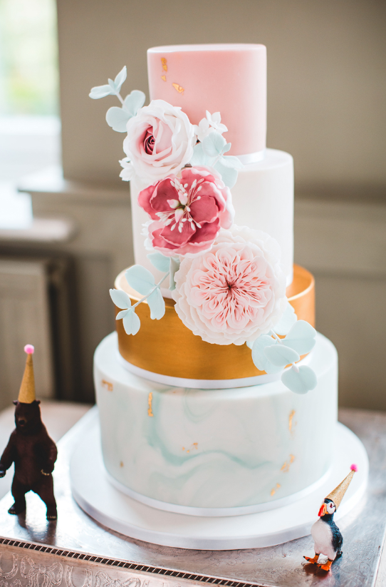 The wedding cake was gold, green marble, pink with sugar and fresh blooms and gold leaf