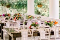 09 The wedding tablescapes were done with uncovered tables, colorful blooms and greenery and neutral napkins