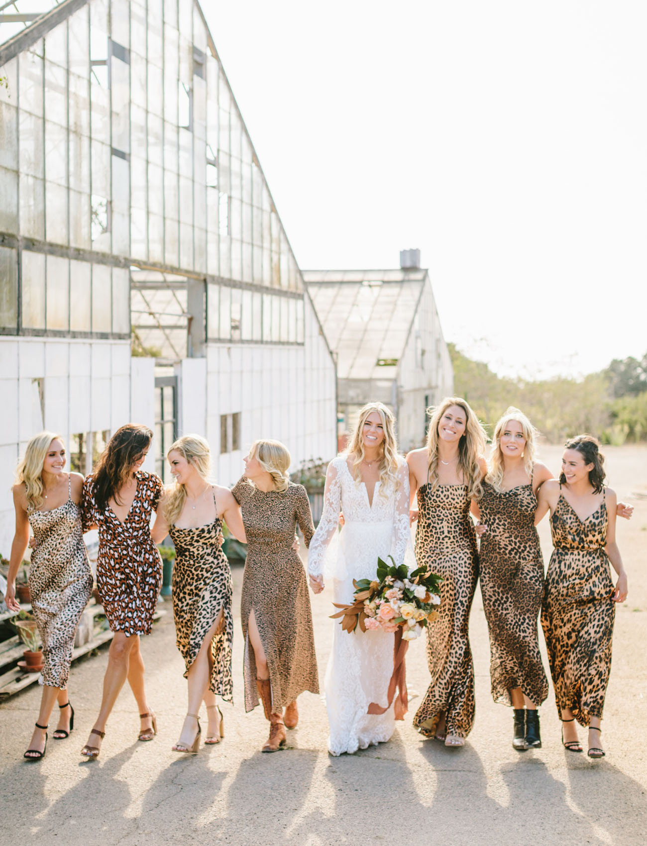 bridesmaids in mismatching leopard print dresses of various looks are super bold and unusual