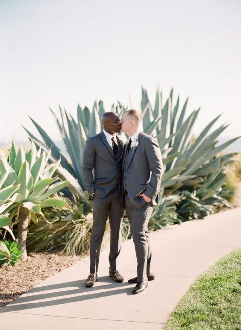 matching grey three-piece wedding suits, black ties and white shirts plus mismatching shoes