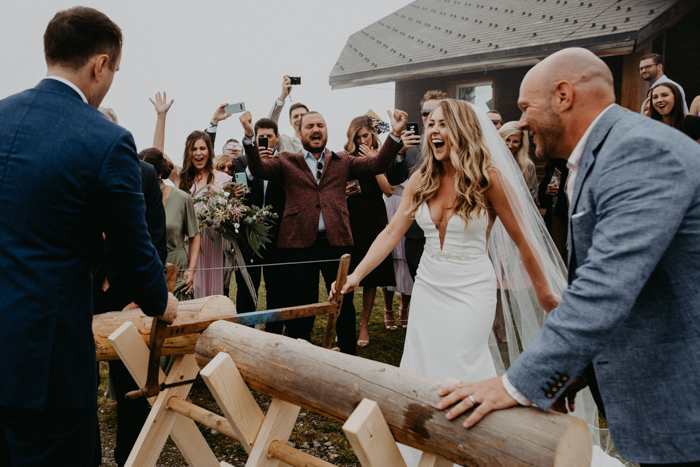 The couple had to saw a large log together right after the ceremony